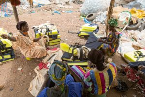 Women in Mali sewing comfortable harnesses for working donkeys
